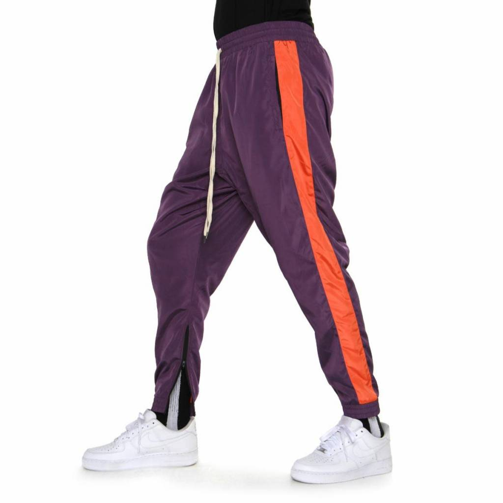 5f187a3c4d7df0 eptm windbreaker track pants (purple/orange) - OSO:a style lab