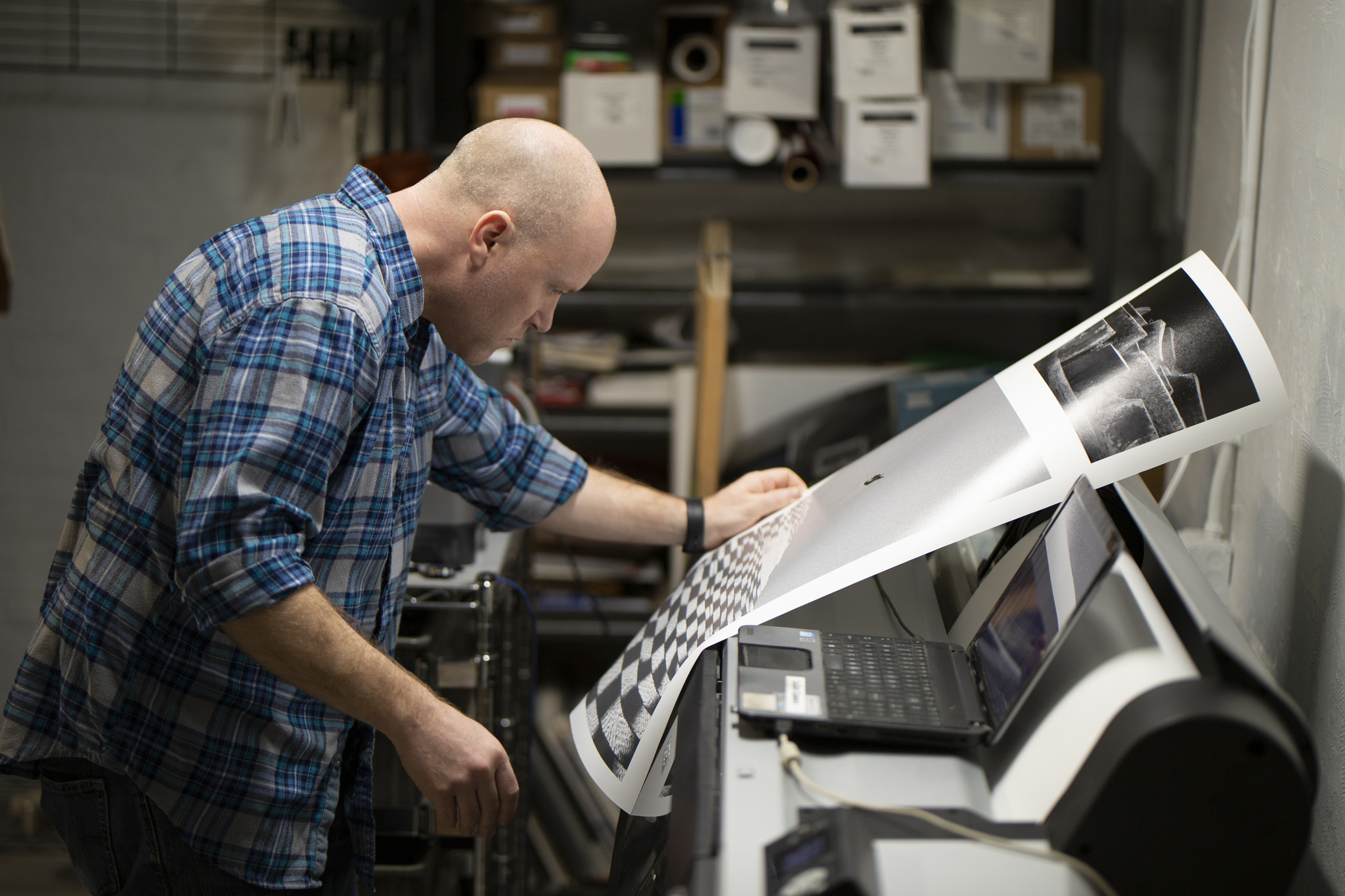 Jason Robinson, our print technician, reviews a print for color-correctness and quality.
