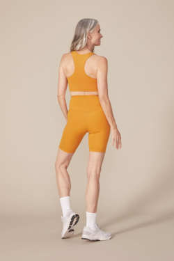 Girlfriend Collective High Rise Bike Short in Honey