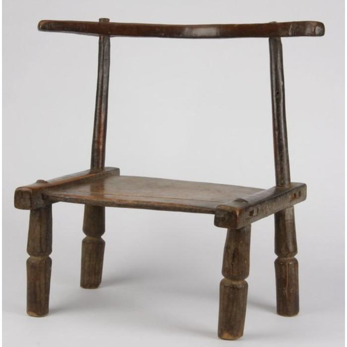Senufo prestige chair with incised river decoration on the seat