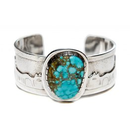 Story Bracelet with Turquoise by Terrance Campbell.