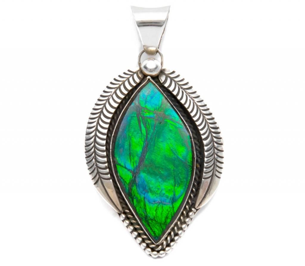 Natural Iniskim Silver Pendant by Bryant Martinez (Navajo).
