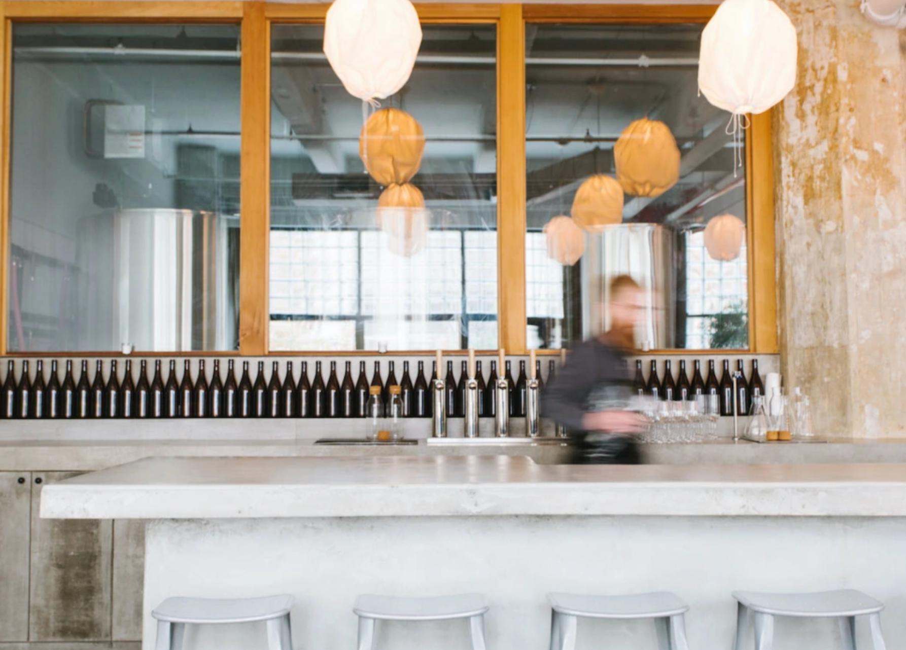 Brandon Doughan moving behind the bar © Polaner Selections