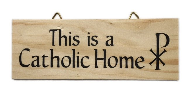This is a Catholic Home Wood Plaque