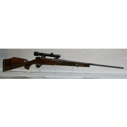 Weatherby CG-0010 USED Weatherby Mark V Left Hand Rifle MFG in Germany .240 Wby. Mag. w/ Redfield 1-4x Scope (excellent condition!)