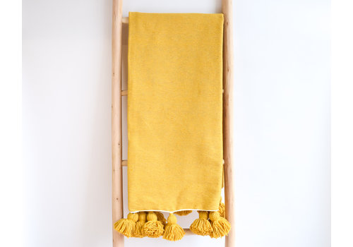 Couverture pompom moutarde