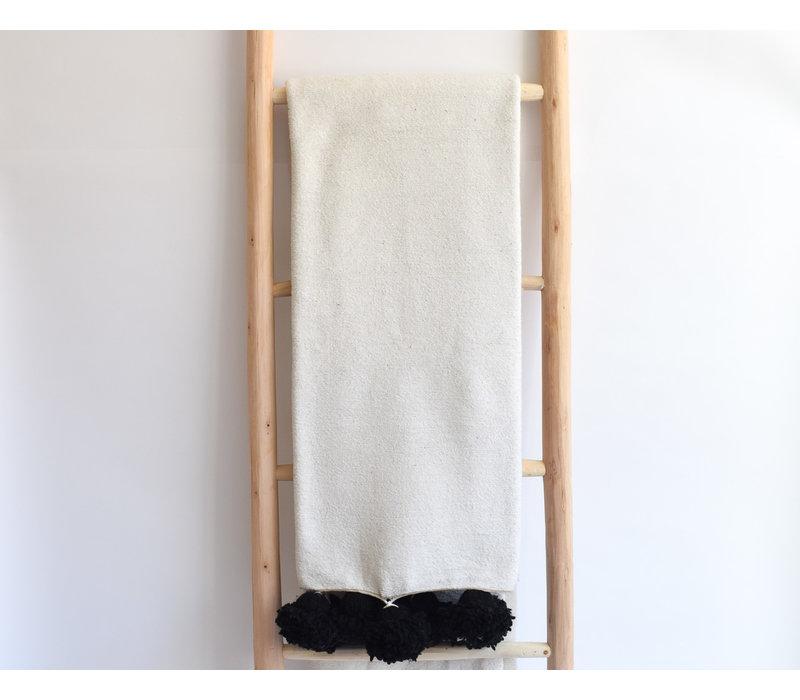 Couverture pompom blanc/noir p.