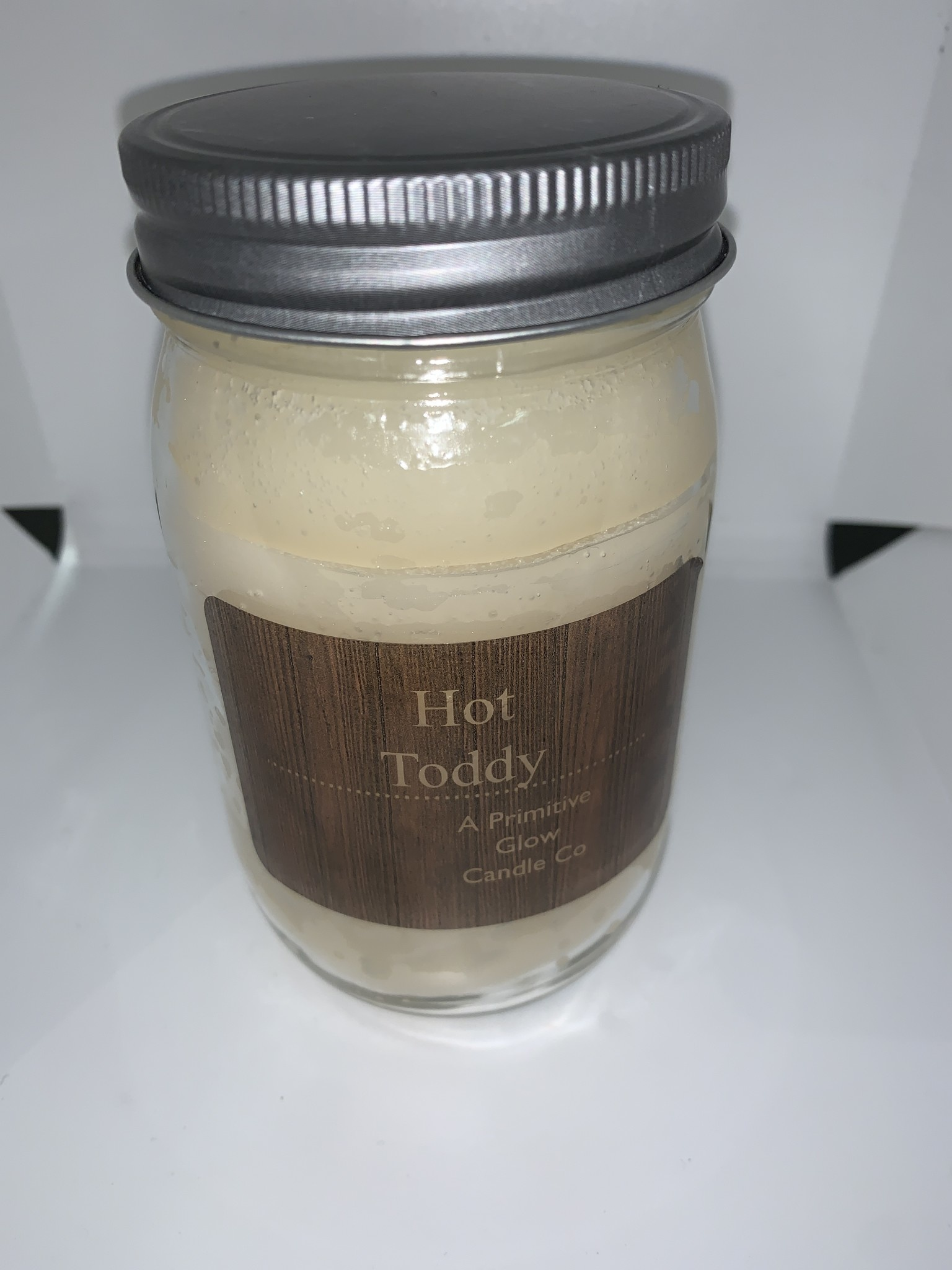 A PRIMITIVE CANDLE CO Hot Toddy  Candle 16oz