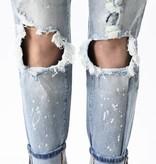 Light Wash Distressed/Paint Splatter Skinny Jeans