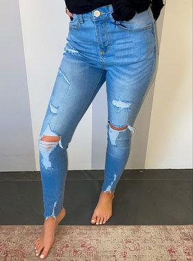 Super Light Wash Distressed Skinny Jeans