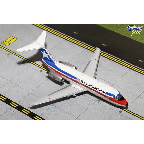Gemini Jets DC9-10 Texas International N1307T 1:200 with stand