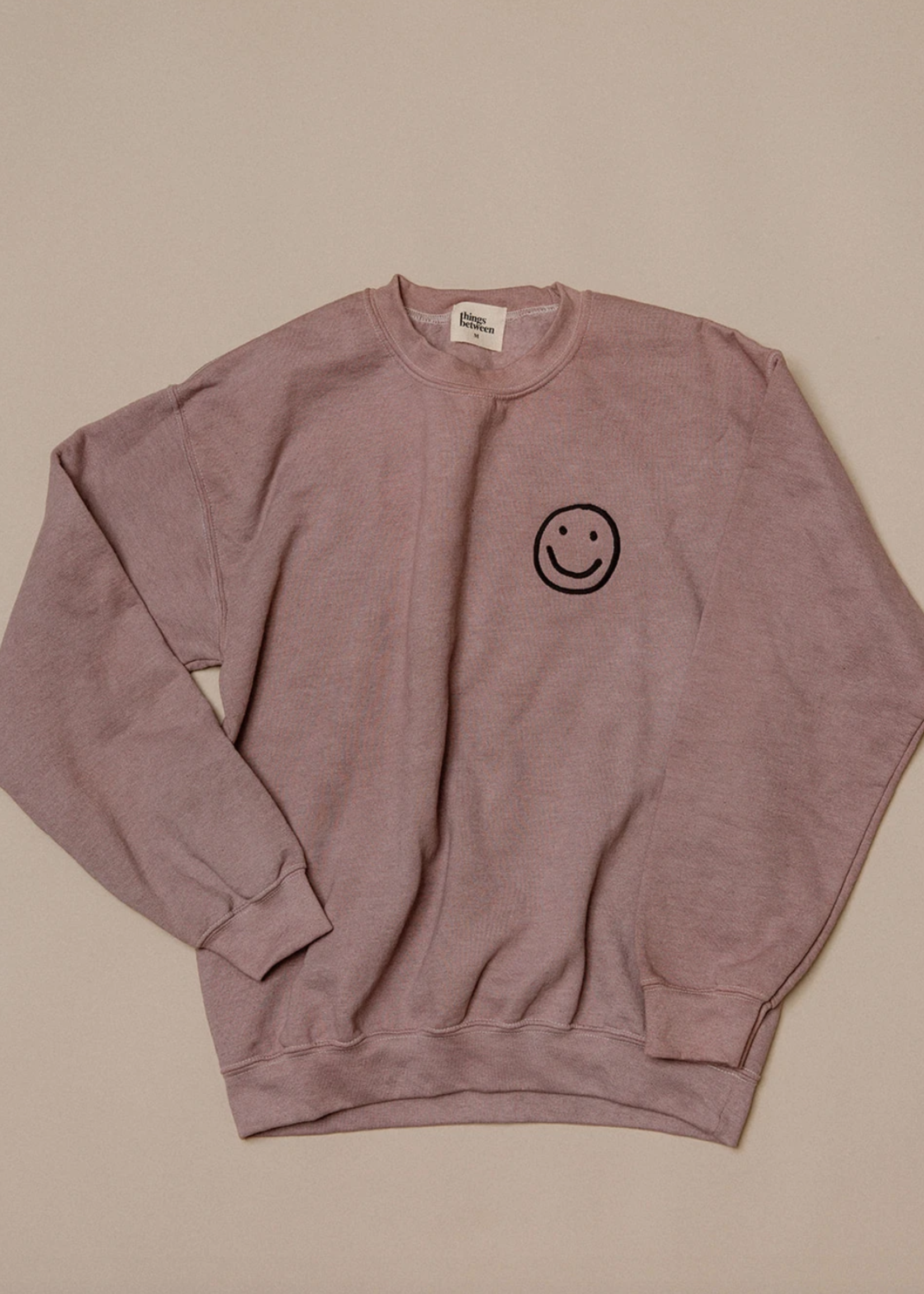 the things between the things between smile crew neck
