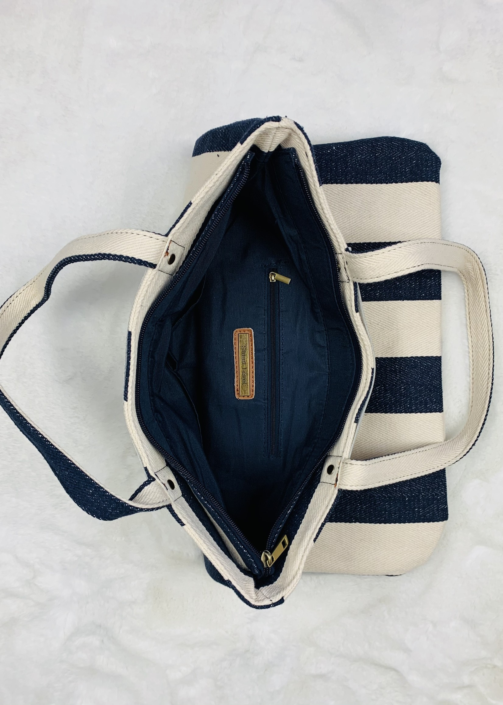 navy and white striped bag
