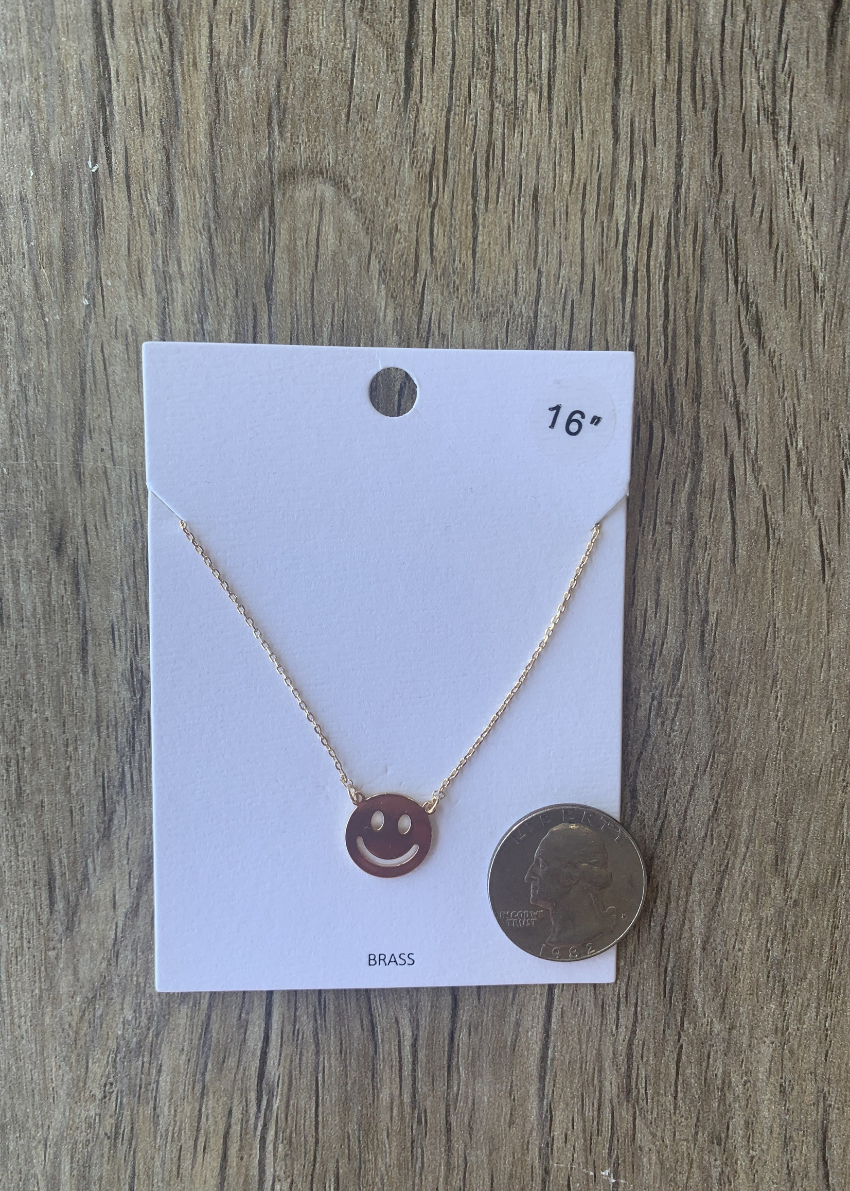 gold smiley face necklace