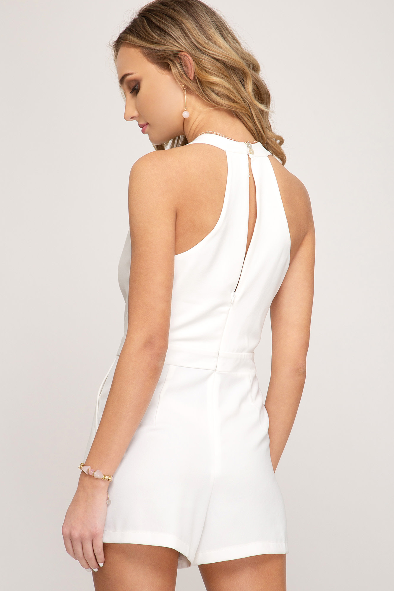 White sleeveless surplice romper