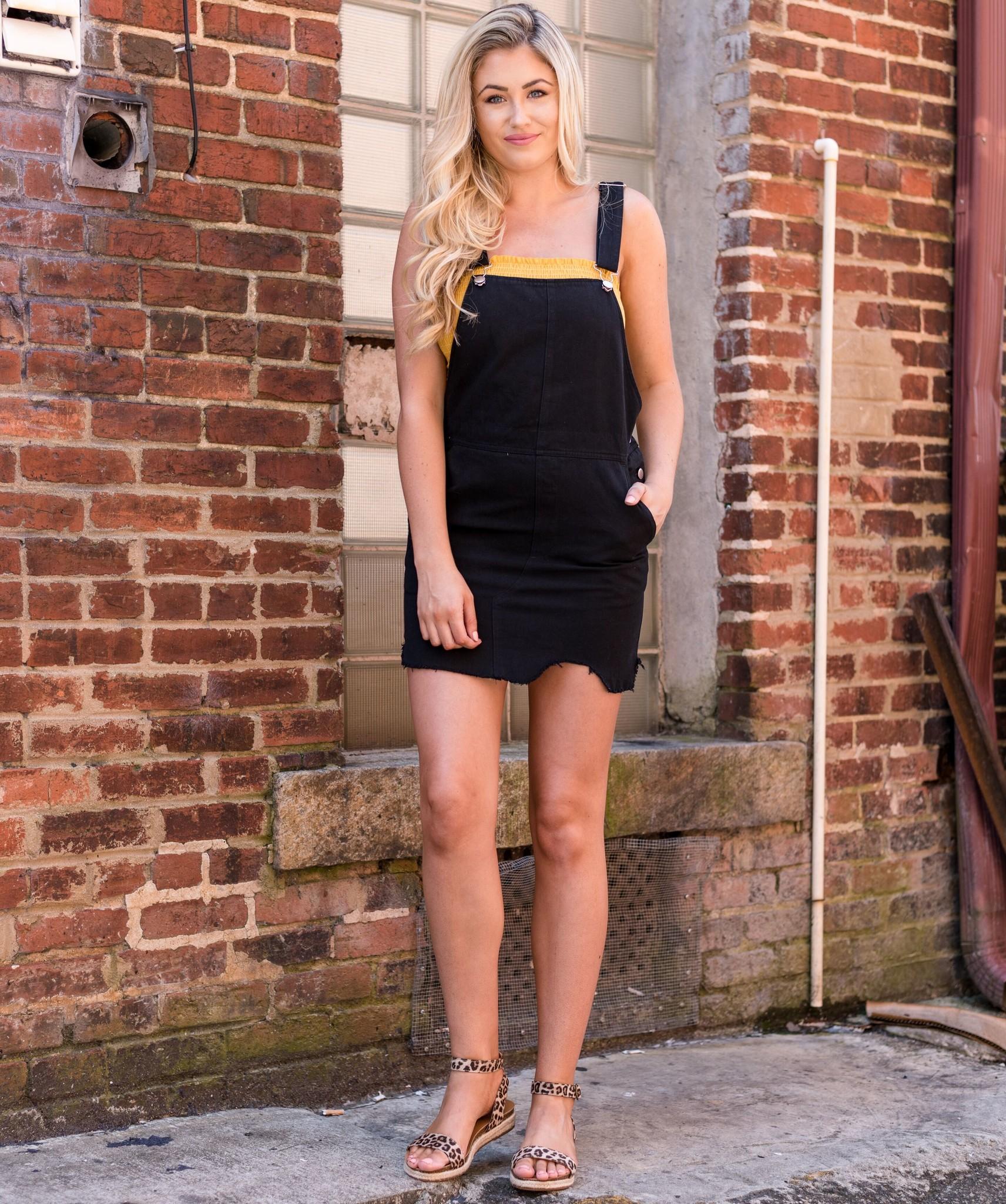 Black denim overall dress w/raw hem