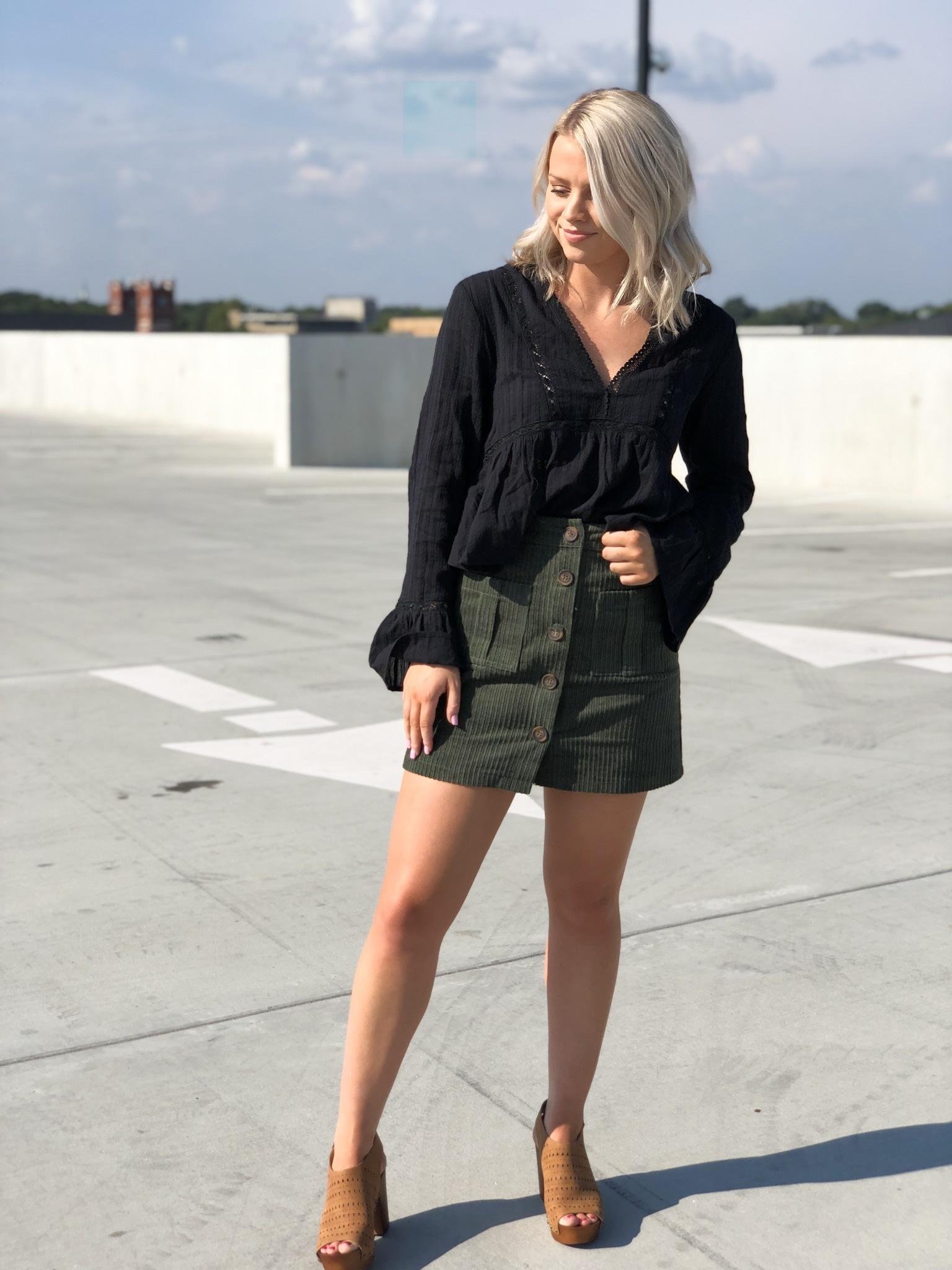 Black peplum top w/bell sleeves and crochet detail