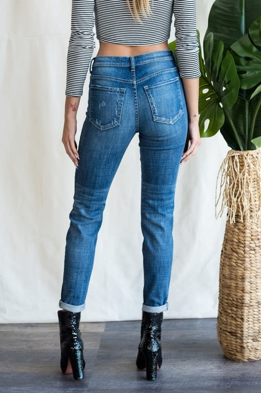 Distressed mid rise skinny tomboy jeans