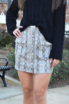 Snake print front button & pocket skirt