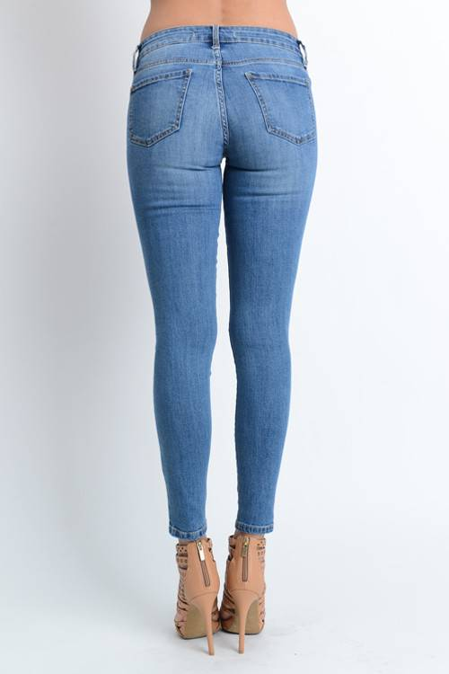 Med Wash low rise skinny ankle jeans
