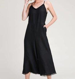 Black open back jumpsuit with frayed hem edges