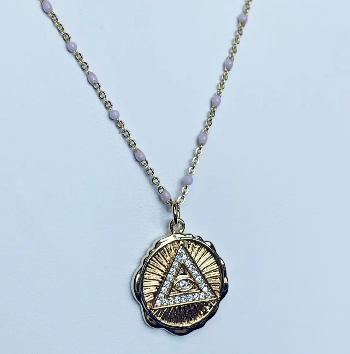 Bou-Cou Cz Triangle on Round Pendant