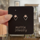 Metrix Jewelry Jamie Triangle Studs-Rose Quartz