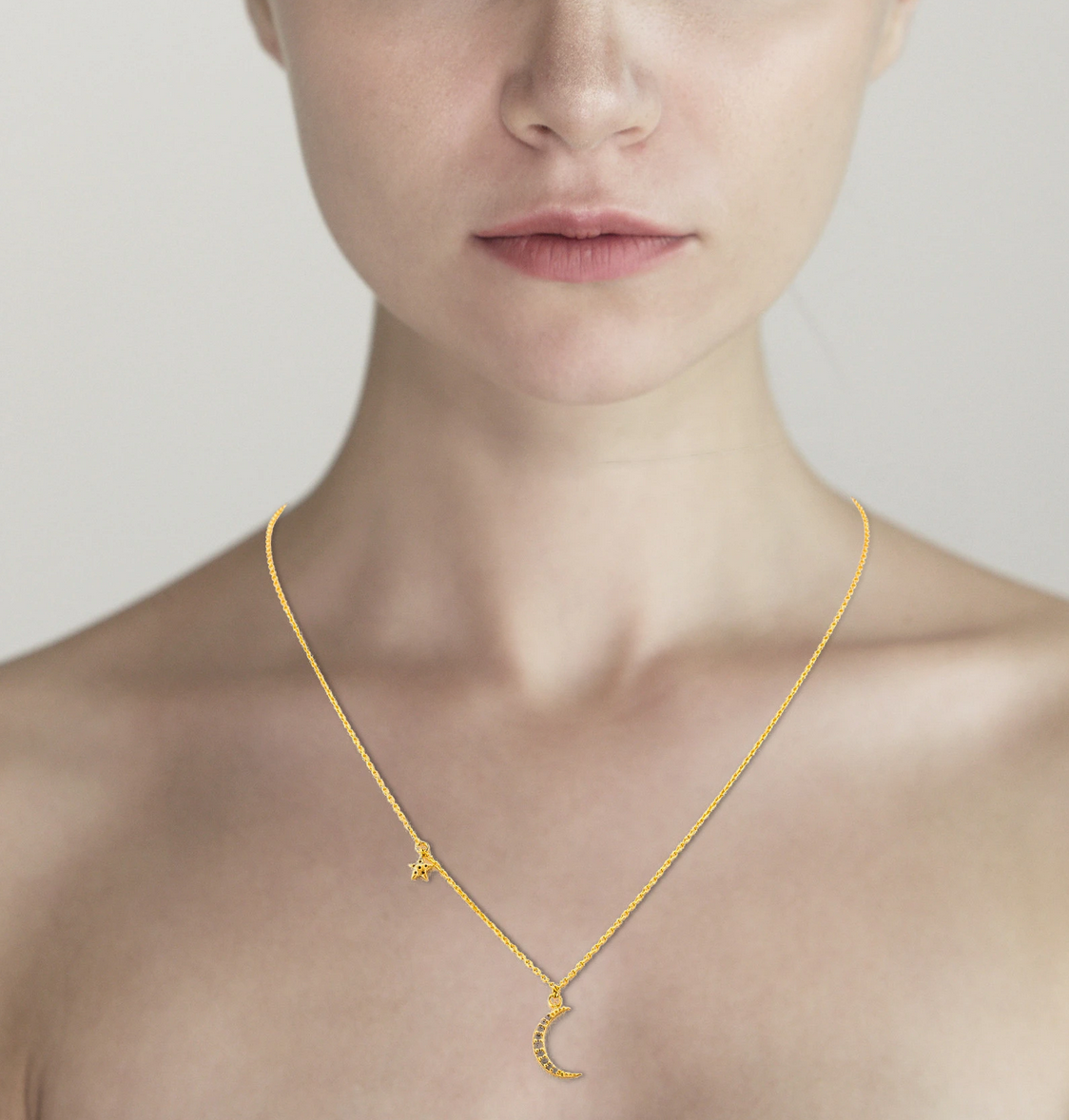 tai Simple gold necklace with celestial charms