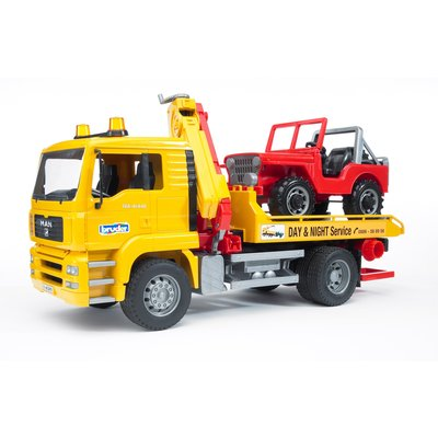 BRUDER TOYS AMERICA MAN TGA TOW TRUCK WITH CROSS COUNTRY VEHICLE BRUDER