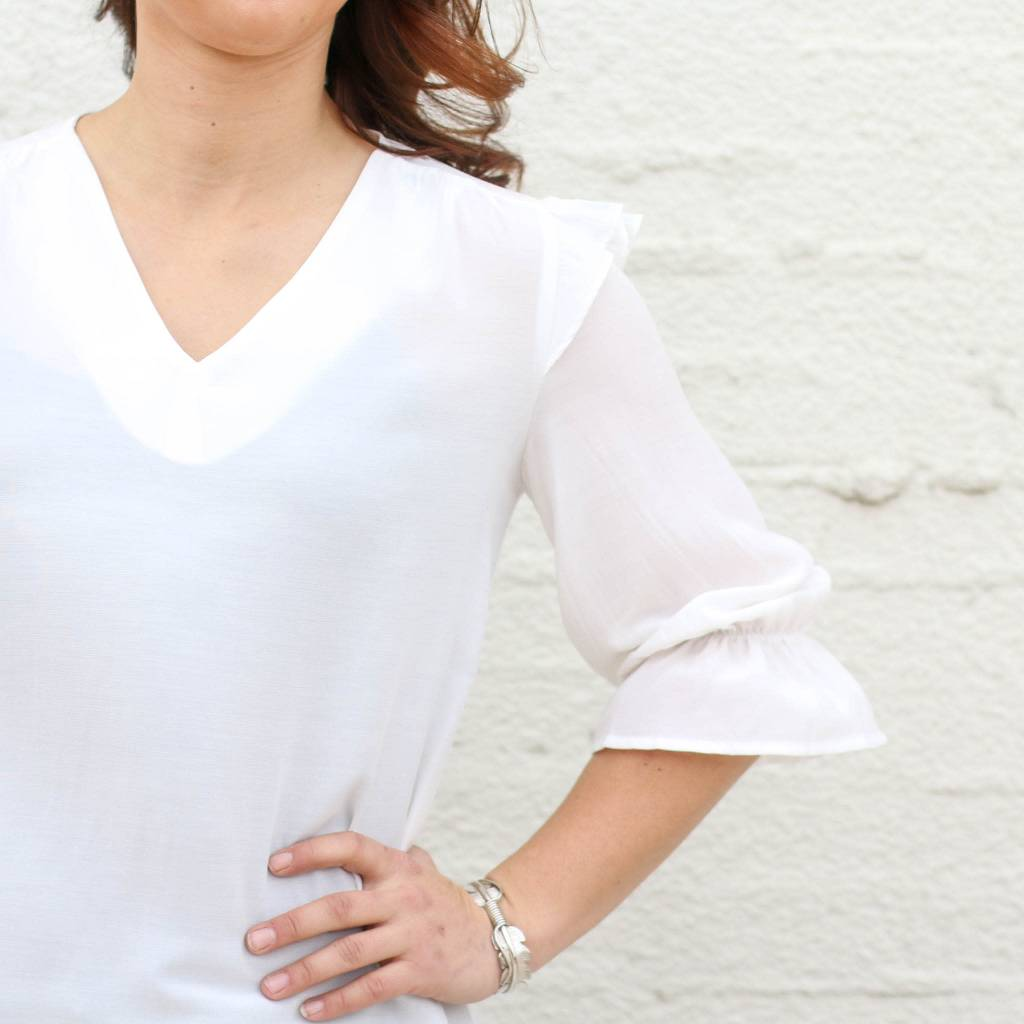 Punchy's White Ruffle Shoulder Statement Top