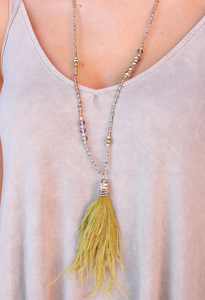 Caroline Hill Rusa wood and glass bead necklace with feather pendant