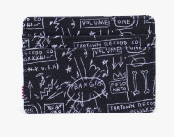 """Celebrating the enigmatic New York City artist's expressive work, the Basquiat Charlie wallet is a compact card holder that features a dynamic print of the """"Beat Bop"""" cover art he created for the 1983 hip hop single."""
