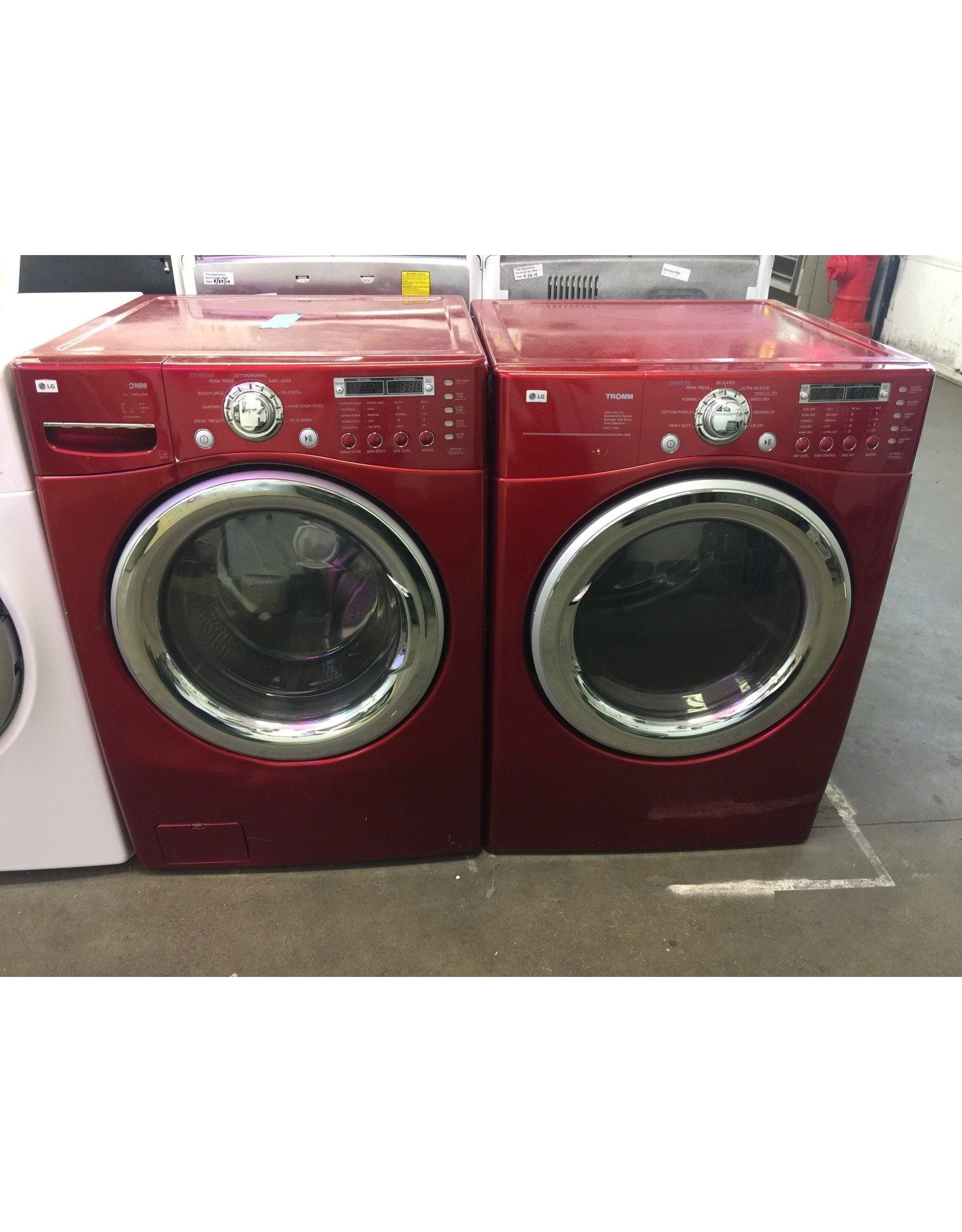 LG LG TROMM FRONT LOAD STEAM WASHING MACHINE IN RED