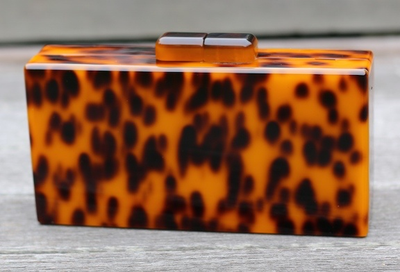 Accessories Here is a smart large tortose clutch<br /> Monogram is available at an additional cost