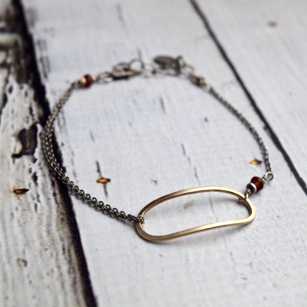 Handmade Bracelet with open 14kt goldfill ovals with 4mm garnet