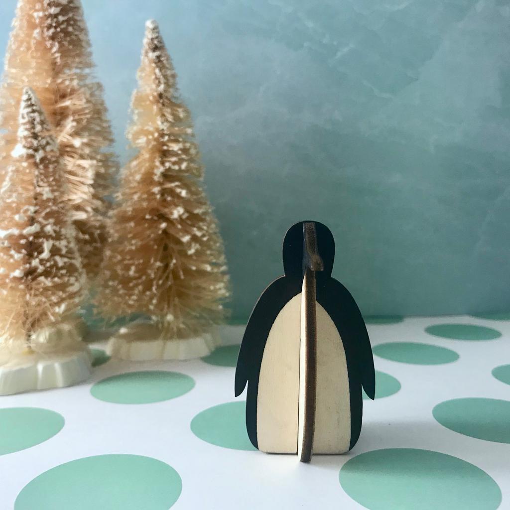 Individual wooden penguin