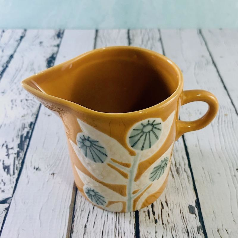 """4""""L x 3-1/4""""W x 4""""H Hand Painted Mustard Stoneware Creamer with Flower"""