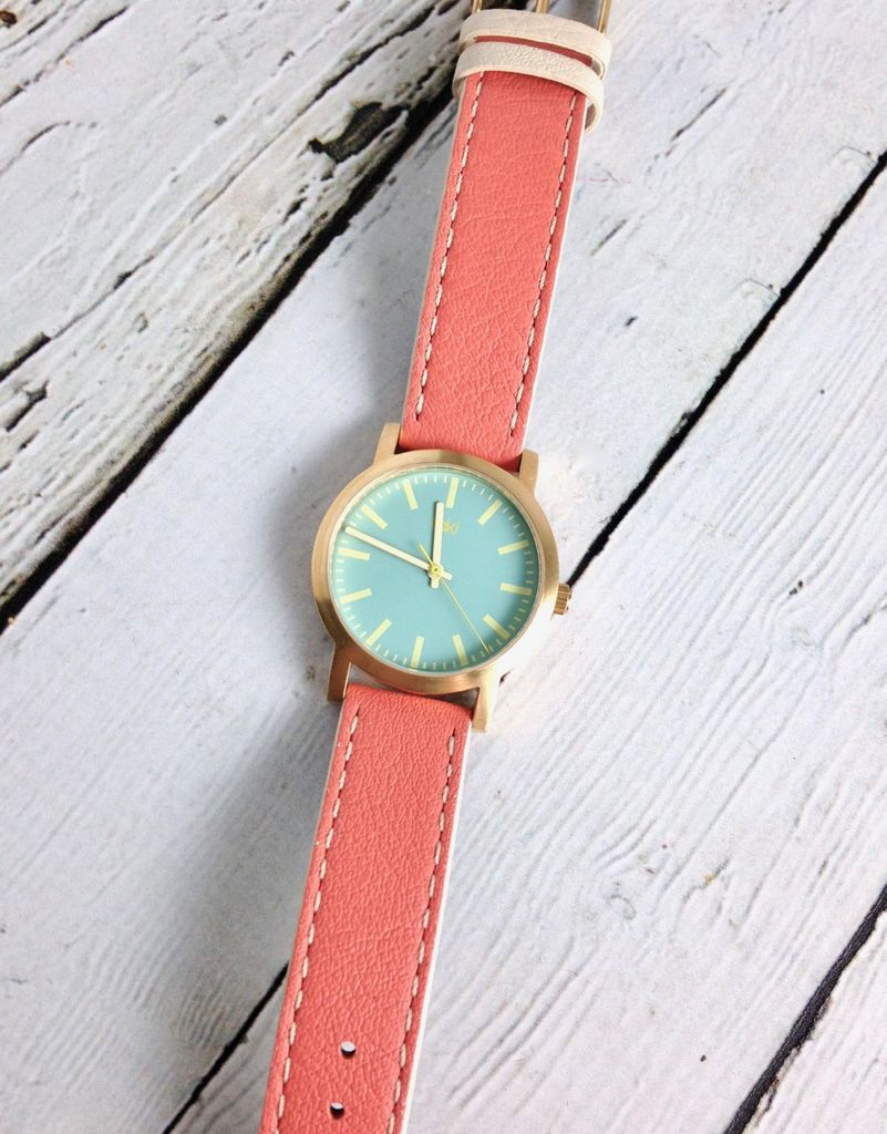 Eden Watch, Light Blue Face and Salmon Orange Band with a Gold-Tone Bezel