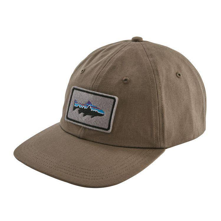 A traditional low-crown, unstructured, six-panel ball cap made from organic cotton, featuring a self-fabric adjustable strap and embroidered patch logo.