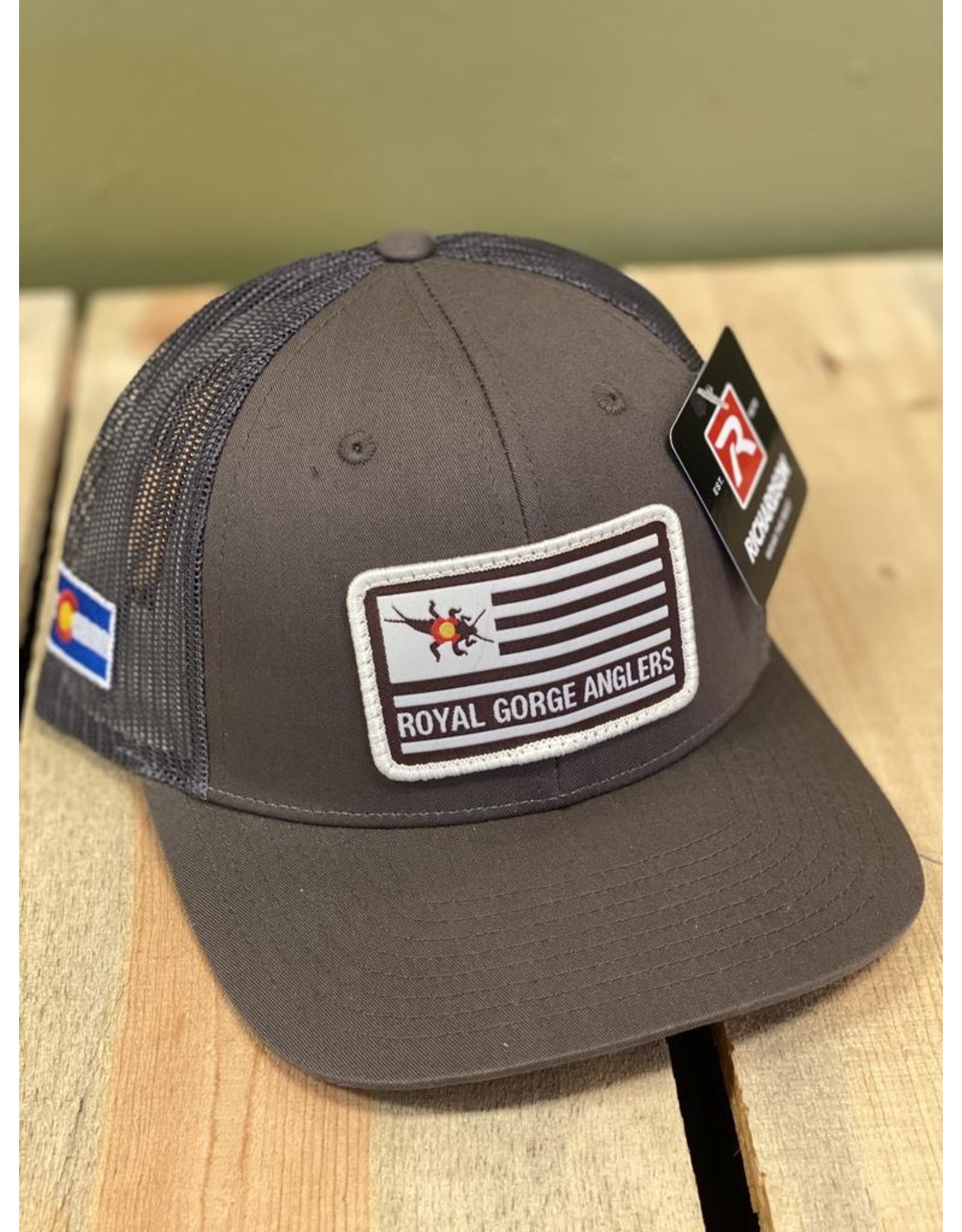 Feast your eyes on the coolest Flag patch Trucker hat to ever hit the water!