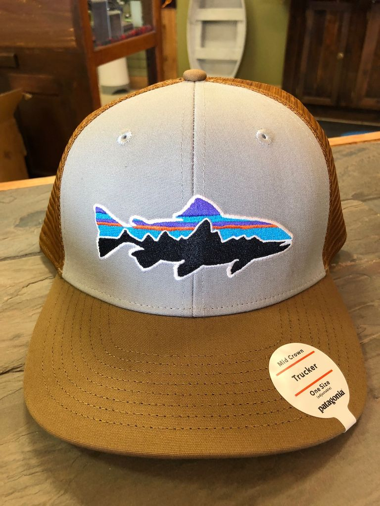 The classic mid-crown trucker hat with an organic cotton front, polyester mesh back, adjustable snap closure and embroidered trout logo.