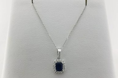 14k White Gold .17ct Diamond and .48ct Sapphire Halo Style Pendant Necklace
