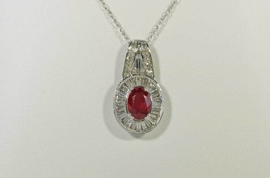 14KW .68CTW-DIA .94CT-RU OVAL RUBY & DIAMOND PENDANT WITH BAGUETTES & ROUND BRILLIANTS