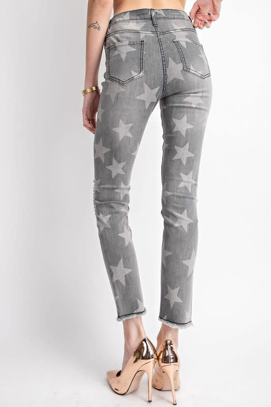 STAR PRINT DISTRESSED DENIM PANTS