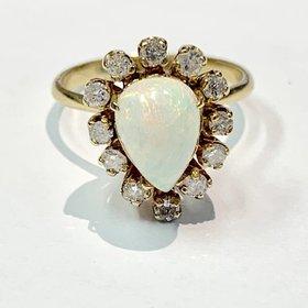 Pear Shape Fiery Opal Ring Surrounded by Diamonds