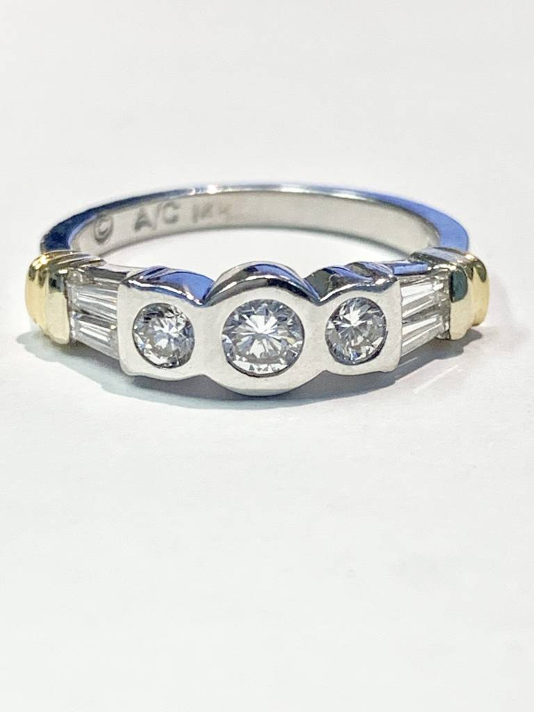 14kt two toned round and baguette diamond ring 0.70 carat total