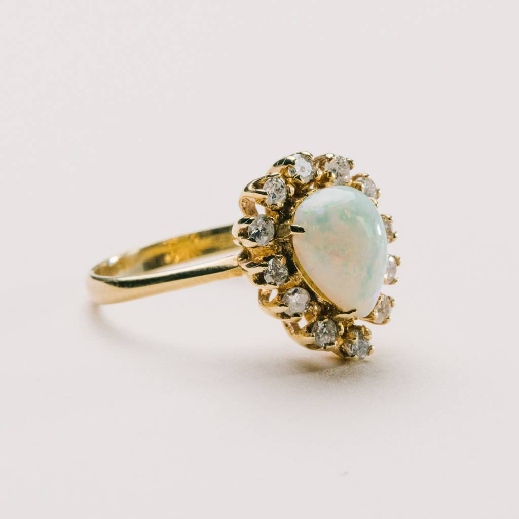 Pear Shape Fiery Opal Ring Surrounded by Diamonds