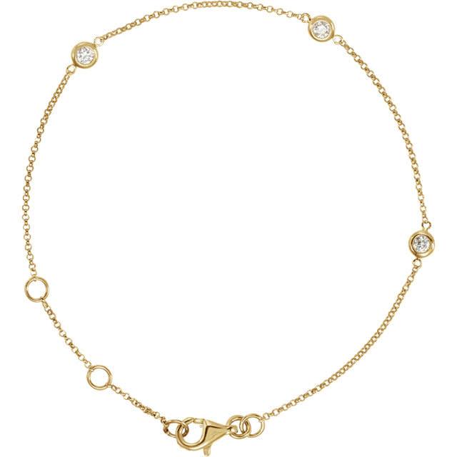 14kt gold diamond bezel station bracelet 1/6 carat total