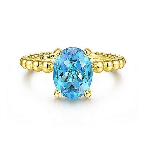 Oval Swiss Blue Topaz Beaded Ring