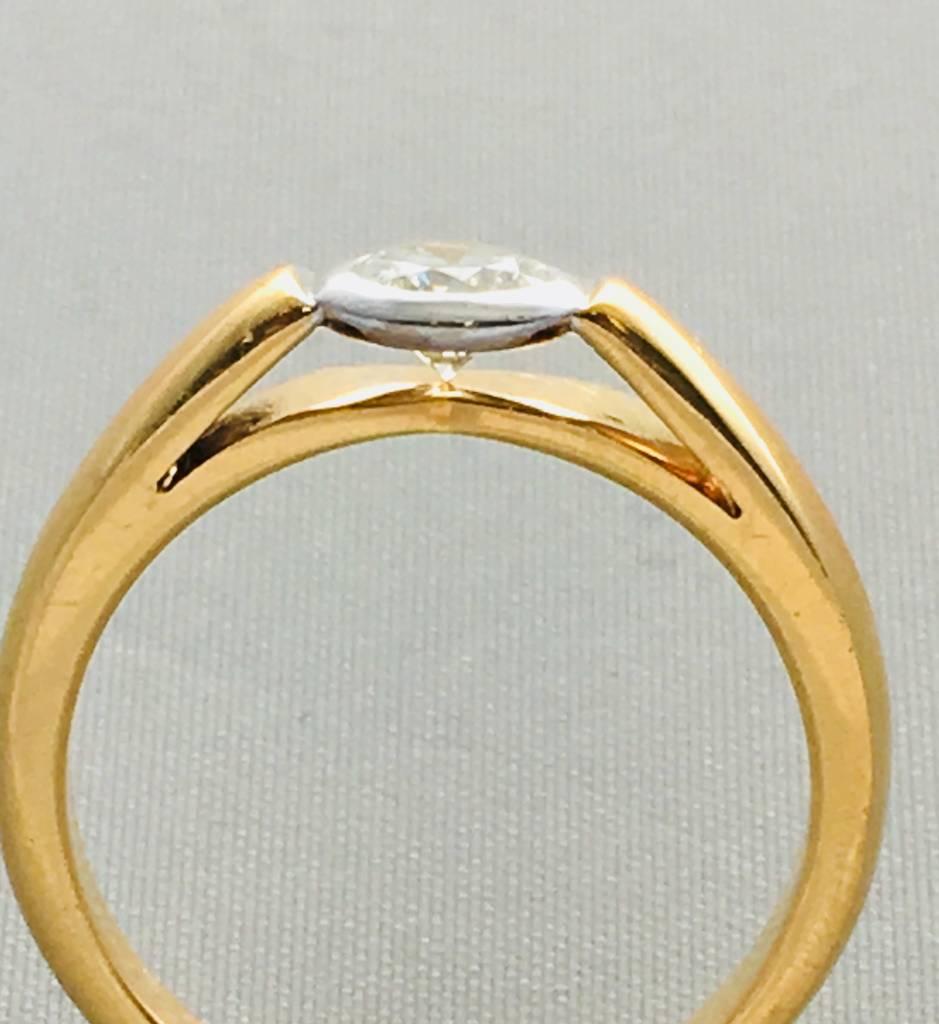 Freedman 0.40 ct rd H/I VS2/SI1 14kt yg bezel ring